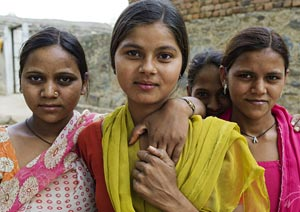 girls gather outside a self-help group meeting in Bagad-Rajput